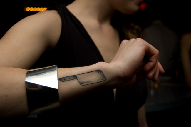 One of the bartenders liked the meat cleaver I drew for the business cards and matchbooks enough to get it permanently added to her body.